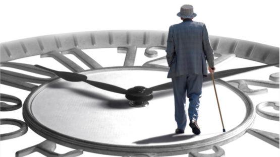 Old man walking on a clock