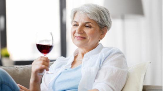 Elderly woman drinking alcohol